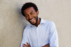 Carefree african american man laughing with arms crossed. Close up portrait of carefree african american man laughing with arms crossed Stock Images