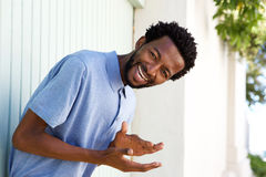 Carefree african american man laughing outside. Portrait of carefree african american man laughing outside Royalty Free Stock Images