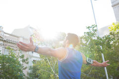 Carefree athlete with arms outstretched Stock Photos