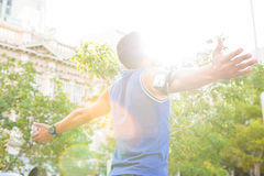 Carefree athlete with arms outstretched Royalty Free Stock Photos