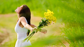 Carefree attractive girl in field Stock Photo