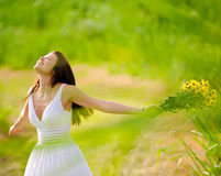 Carefree attractive girl in field. Carefree adorable girl with arms out in field. summer freedom andjoy concept Stock Image