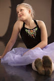 Carefree Ballet Student Sitting Royalty Free Stock Photos