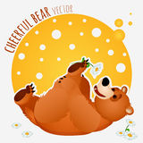 Carefree bear lies and plays with a flower. Carefree bear plays with a flower Royalty Free Stock Images