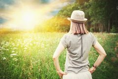 Carefree beautiful woman enjoying of sunlight in the meadow. Outdoor Royalty Free Stock Photos