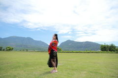 Carefree beauty at foot of montain, healthy living concept, pure happiness and freedom. Asian Chinese Carefree woman on snow mountain, healthy living concept Royalty Free Stock Photos