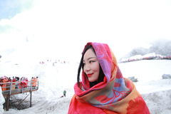 Carefree beauty on snow montain, healthy living concept, pure happiness and freedom. Asian Chinese Carefree woman on snow mountain, healthy living concept, pure Stock Images