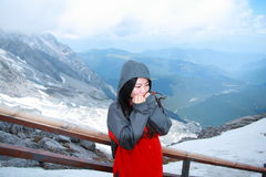 Carefree beauty on snow montain, healthy living concept, pure happiness and freedom. Asian Chinese Carefree woman on snow mountain, healthy living concept, pure Stock Photography