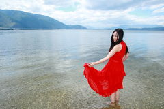 Carefree beauty walk in the sea, healthy living concept, pure happiness and freedom. Asian Chinese woman enjoy free time, beautiful graceful girl, healthy living Royalty Free Stock Images