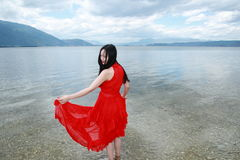 Carefree beauty walk in the sea, healthy living concept, pure happiness and freedom. Asian Chinese woman enjoy free time, beautiful graceful girl, healthy living Stock Photos