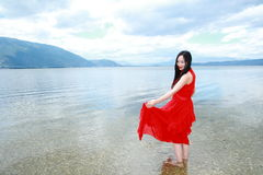 Carefree beauty walk in the sea, healthy living concept, pure happiness and freedom. Asian Chinese woman enjoy free time, beautiful graceful girl, healthy living Royalty Free Stock Photos