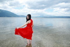 Carefree beauty walk in the sea, healthy living concept, pure happiness and freedom. Asian Chinese woman enjoy free time, beautiful graceful girl, healthy living Royalty Free Stock Photography
