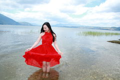 Carefree beauty walk in the sea, healthy living concept, pure happiness and freedom. Asian Chinese woman enjoy free time, beautiful graceful girl, healthy living Stock Photography