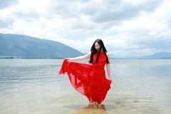 Carefree beauty walk in the sea, healthy living concept, pure happiness and freedom. Asian Chinese woman enjoy free time, beautiful graceful girl, healthy living Royalty Free Stock Image