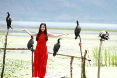Carefree beauty at Yunnan Erhai, healthy living concept, pure happiness and freedom. Asian Chinese Carefree woman on snow mountain, healthy living concept, pure Stock Images