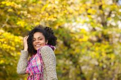 Carefree black woman smiling outdoors Stock Photo