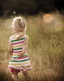 Carefree blond girl runs outdoors Stock Photography