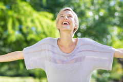Carefree blonde in a park Royalty Free Stock Photos