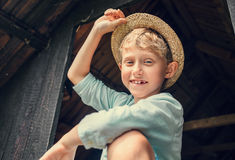 Carefree boy in straw hat Royalty Free Stock Image