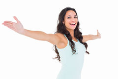 Carefree brunette with arms out Stock Images