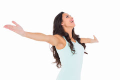 Carefree brunette with arms out Royalty Free Stock Images