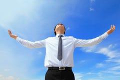 Carefree business man arms up Stock Photos