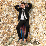 Carefree businessman. On deck on the money Royalty Free Stock Images