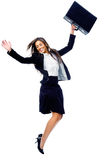 Carefree Businesswoman Jump Stock Photo