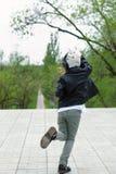 Trendy schoolchild walk in the city
