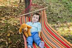 Carefree child in hammock Stock Image