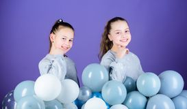 Carefree childhood. Sisters organize home party. Greeting concept. Having fun concept. Balloon theme party. Girls. Friends near air balloons. Start party stock photo