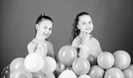 Carefree childhood. Sisters organize home party. Greeting concept. Having fun concept. Balloon theme party. Girls. Friends near air balloons. Start party stock photos