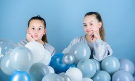 Carefree childhood. Sisters organize home party. Having fun concept. Balloon theme party. Girls best friends near air. Balloons. Start this party. Birthday stock photography