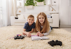 Carefree children entertaining at home Stock Photos