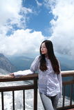 Carefree Chinese beauty look towards on Jade dragon snow mountain. Chinese girl climb Jade dragon snow mountain at Yunnan province, it is a very famous snow stock photos