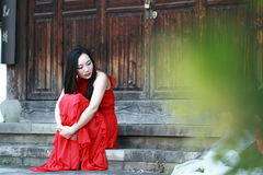 Carefree Chinese beauty rest in a park Stock Photo