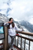 Carefree Chinese beauty on Yunnan Jade dragon snow mountain Stock Image