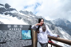Carefree Chinese beauty on Yunnan Jade dragon snow mountain Stock Images