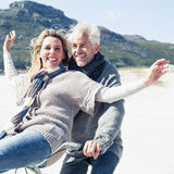 Carefree couple going on a bike ride on the beach Royalty Free Stock Photo