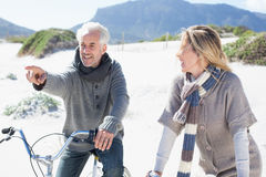 Carefree couple going on a bike ride and picnic on the beach Royalty Free Stock Image