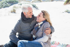 Carefree couple having picnic on the beach Stock Photo