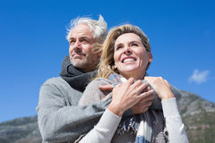 Carefree couple hugging in warm clothing Royalty Free Stock Images