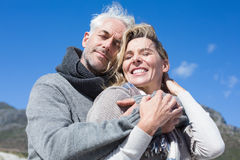 Carefree couple hugging in warm clothing Royalty Free Stock Image
