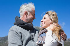 Carefree couple hugging in warm clothing Royalty Free Stock Photo