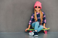 Carefree cutie with skateboard. Royalty Free Stock Photos