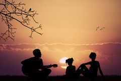 Carefree family plays and sings Royalty Free Stock Images