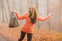 Carefree fashion woman relaxing in autumn park. Stock Photos