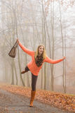 Carefree fashion woman relaxing in autumn park. Stock Image