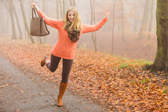 Carefree fashion woman relaxing in autumn park. Royalty Free Stock Photography