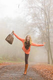 Carefree fashion woman relaxing in autumn park. Royalty Free Stock Photos